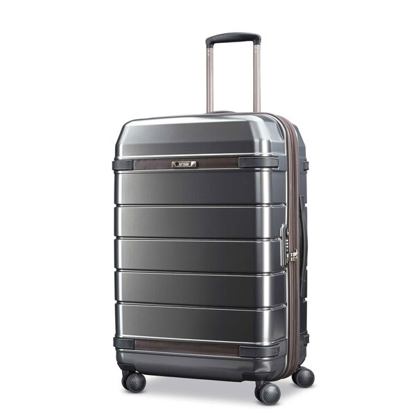 Hartmann Century Hardside Medium Journey Expandable Spinner in the color Graphite/Espresso.