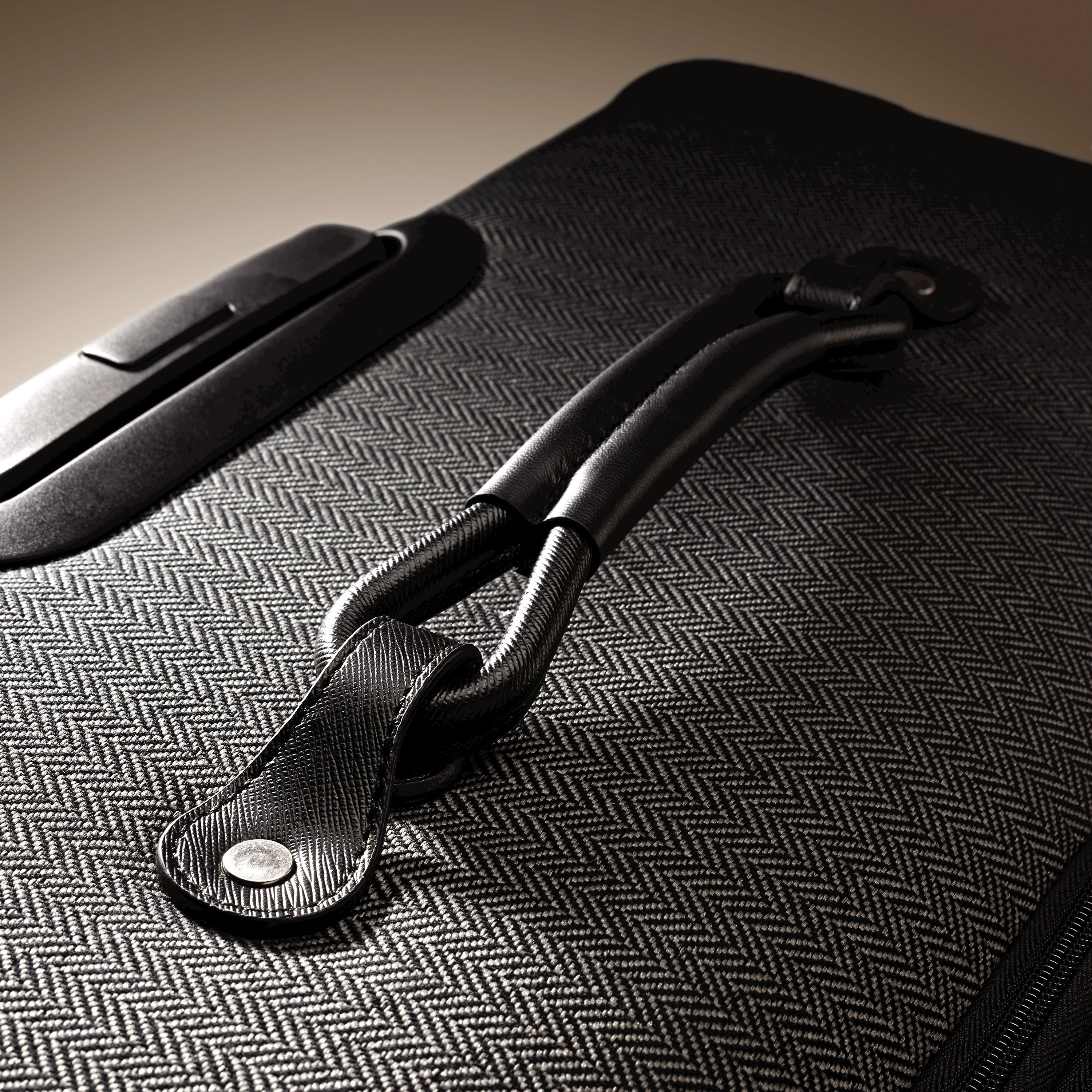 e9ceb788df2b Hartmann Herringbone Luxe SS Carry On Spinner in the color Black.